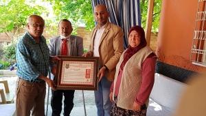 Başkan İsmail Kumartaşlı ve Hasan Ceylan, Şehit Ailesinin Beratını ve Anneler Gününü Kutladı