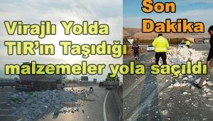Dinar'da Virajlı Yolda TIR'ın üzerinde ki malzemeler yere saçıldı